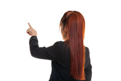 Back of Asian business woman touching the screen with her finger Stock Image