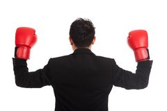 Back of Asian businessman with red boxing glove Stock Photos