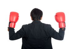 Back of Asian businessman wear boxing gloves Royalty Free Stock Photos