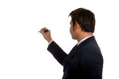 Back of Asian businessman  write in the air Royalty Free Stock Photography