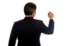 Back of Asian businessman write on whiteboard Stock Images