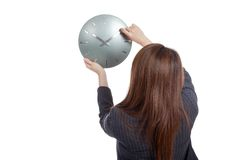 Back of Asian Businesswoman move a clock hand Stock Photos