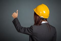 Back of Asian engineer girl show thumbs up Stock Photo