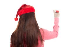Back of Asian girl with christmas hat wirte with red pen Stock Photo