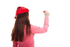 Back of Asian girl with christmas hat wirte with red pen Stock Photos