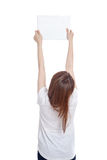 Back of Asian girl hold blank sign with both hands Royalty Free Stock Images