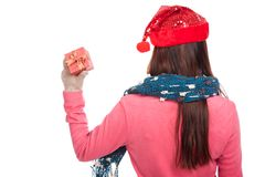 Back of asian girl with red christmas hat show a gift box Stock Photo