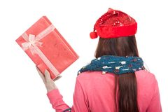 Back of asian girl with red christmas hat show a gift box Royalty Free Stock Photos
