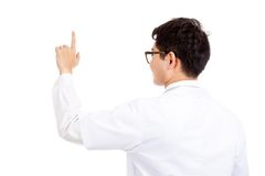 Back of  Asian male doctor touch screen with pointing finger Stock Photo