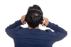 Back of asian man with listen to music and look up. Isolated on white background Royalty Free Stock Image