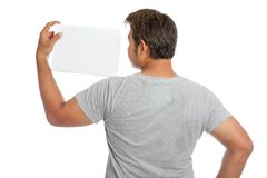 Back of Asian strong man  flexing biceps show blank sign look at Stock Photo