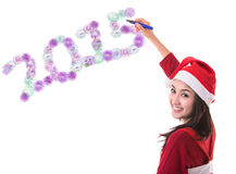 Back of Asian woman with christmas hat write Stock Photo