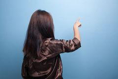 Back of Asian woman touching the screen with her finger. Stock Photos