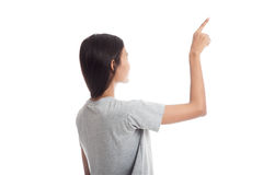 Back of Asian woman touching the screen with her finger. Royalty Free Stock Image