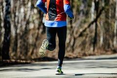 Back athletic runner man. Running asphalt road in city Stock Photo