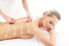 Back of an attractive woman getting massage treatment Royalty Free Stock Photos