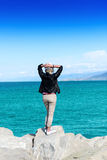 Back of an attractive young woman in hat. The back of an attractive young woman looking at the ocean view Stock Photos