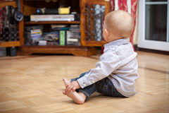 Back of baby boy child kid indoor. At home. Stock Photo