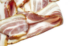 Back Bacon. Britiish back bacon joint with slices. Highly detailed texture int he slice stock photos