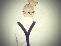 Back of a bald-headed man with glasses on nape Royalty Free Stock Images