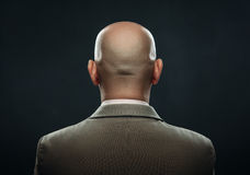 The back of a bald man in suit Royalty Free Stock Photos