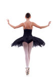 Back of a ballerina. Back picture of a ballerina wearing a black tu tu over white royalty free stock photos