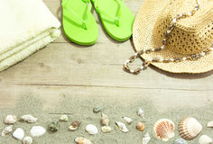 Back from the beach green flip flop. These objects symbolize the theme of holidays and the beach Royalty Free Stock Photos