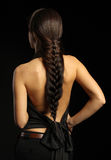 Back is a beautiful brunette with braided brai Royalty Free Stock Photos