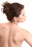 Back of a Beauty. Beautiful woman with back to camera, face facing right, hair up royalty free stock photography