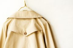 The back of a beige elegant trench coat isolated over white. Close up Royalty Free Stock Photos