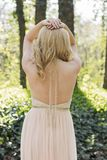 Back of blond woman in evening gown posing Royalty Free Stock Photos