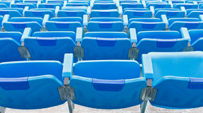 Back of Blue empty plastic seats Royalty Free Stock Photography
