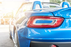 Back of a blue sport car in sunset Stock Image