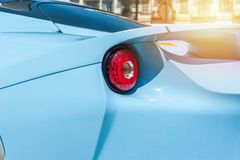 Back of a blue sport car in sunset Royalty Free Stock Photo