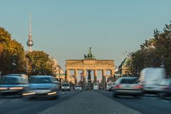 Brandenburg Gate on Street with traffic and tv tower on background stock photos