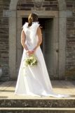 Back of bride. Shot of a back a bride holding a flower arrangement royalty free stock photos