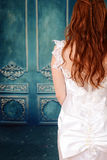 Back of bride with blue wood wall Stock Photography