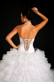 Back of bride and dress. Isolated on black background Royalty Free Stock Photo