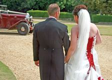 Back of Bride and Groom Walking Stock Photo