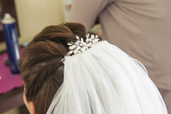 Back of brides head showing hair piece Stock Photos