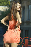 Back of brunette in coral dress Royalty Free Stock Image