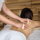 Back brush massage at luxury spa centre Stock Image