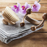Back brush and towel on wood background for massage and exfoliation Royalty Free Stock Image