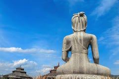 Back of buddha image and blue sky Royalty Free Stock Photos