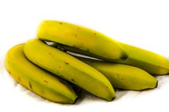The back of a bunch yellow and green banana `s. Fruits of four different banana cultivars A banana is an edible fruit – botanically a berry[1][2] – produced Royalty Free Stock Image