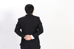 back of business man in black suit looking Stock Photography