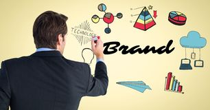 Back of business man with marker against brand doodles and yellow background stock image
