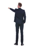 Back of business man pointing with hand in pocket Royalty Free Stock Photography