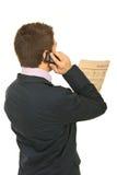 Back of business man reading news Stock Photos