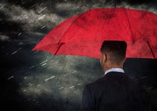 Back of business man with umbrella against rain and clouds with grunge overlay. Digital composite of Back of business man with umbrella against rain and clouds Royalty Free Stock Photography